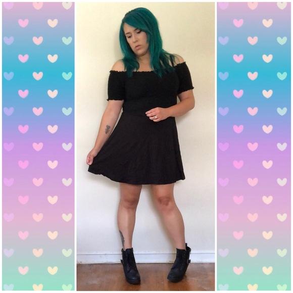 156dc477d945 New Look Off Shoulder Smocked Black Mini Dress. M_5b830de65098a0acca93e571